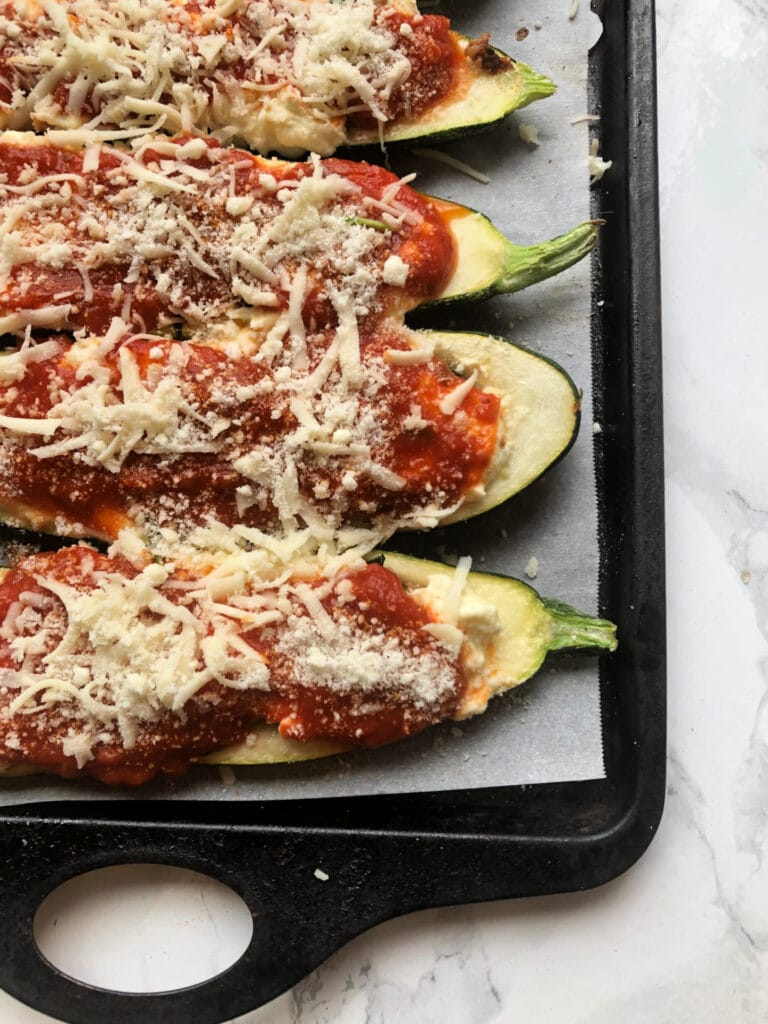 A tray of Lasagna Stuffed Zucchini Boats ready for the oven