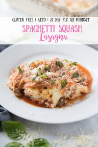 White circular plate of Spaghetti Squash Lasagna topped with fresh basil and