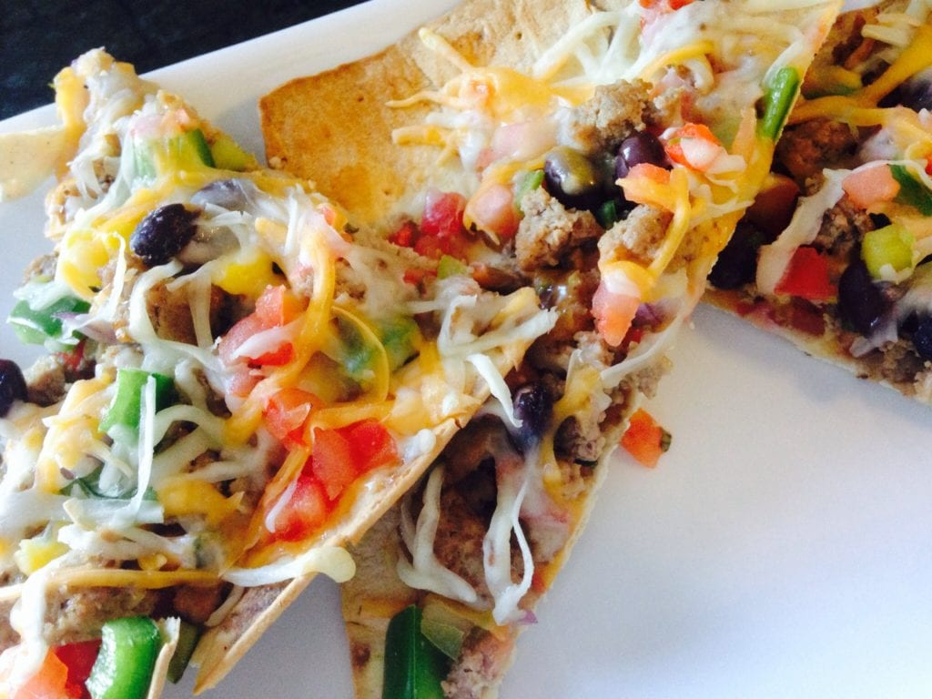 Taco pizza may sound unhealthy, but this 21 Day Fix version is anything but! For your next pizza night, try this easy, delicious healthy comfort food.
