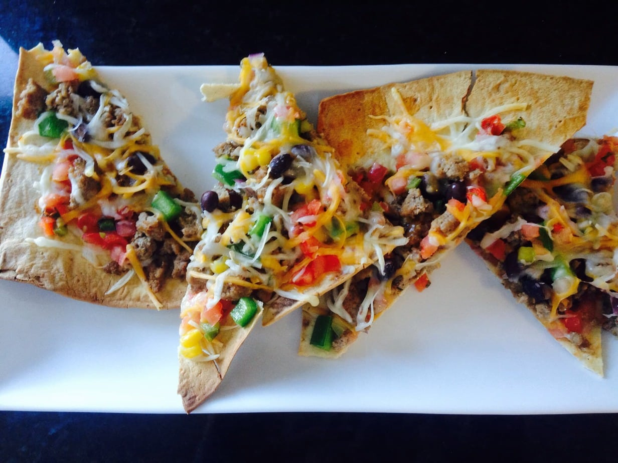 Taco pizza may sound unhealthy, but this 21 Day Fix version is anything but! For your next pizza night, try this easy, delicious healthy comfort food recipe.