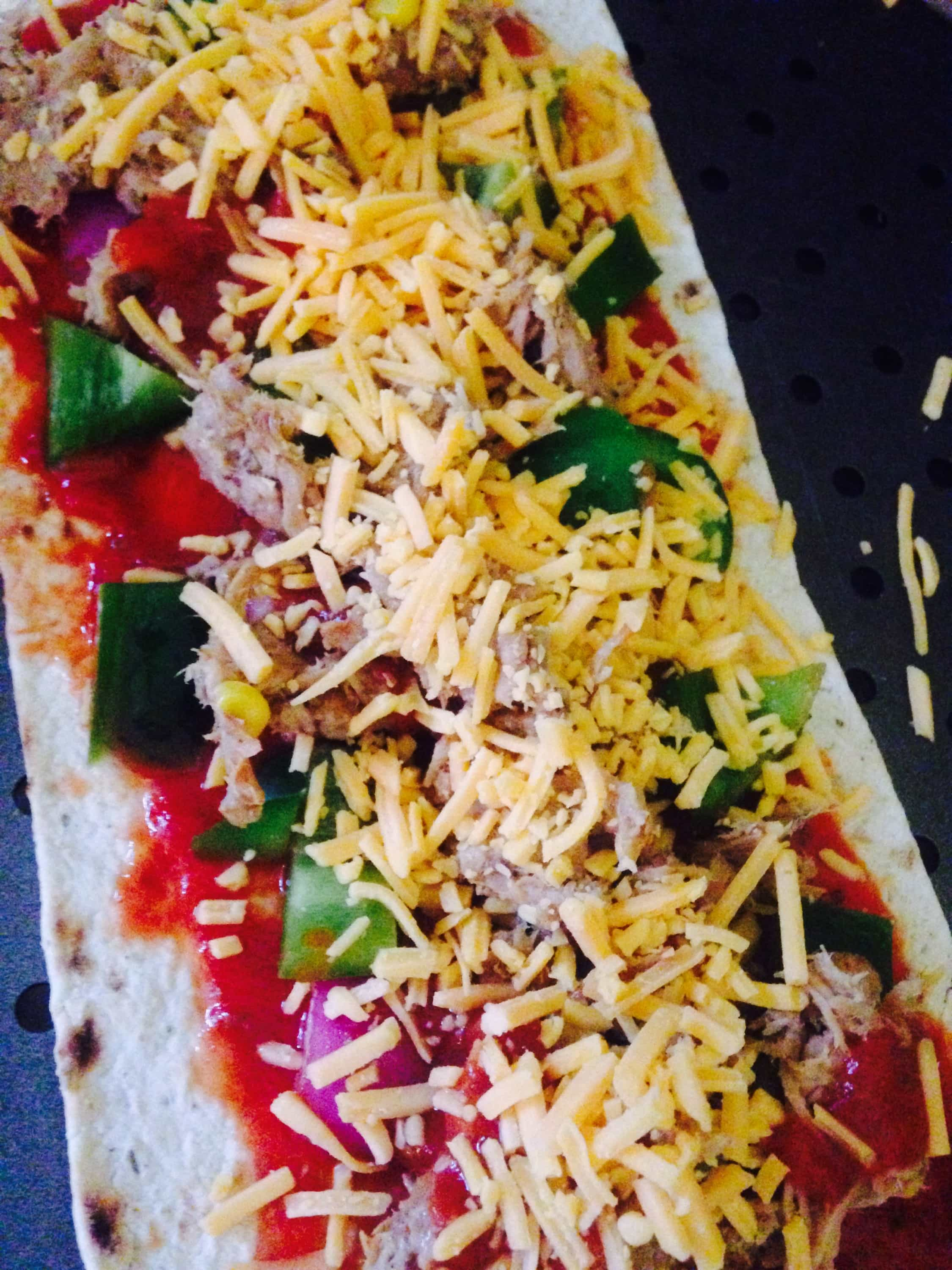 Pork Enchiladas Flatbread Pizza - a healthy comfort food, made with leftover pork carnitas, homemade enchilada sauce, peppers, onions, and cheddar cheese. It is a delicious, 21 Day Fix approved meal!