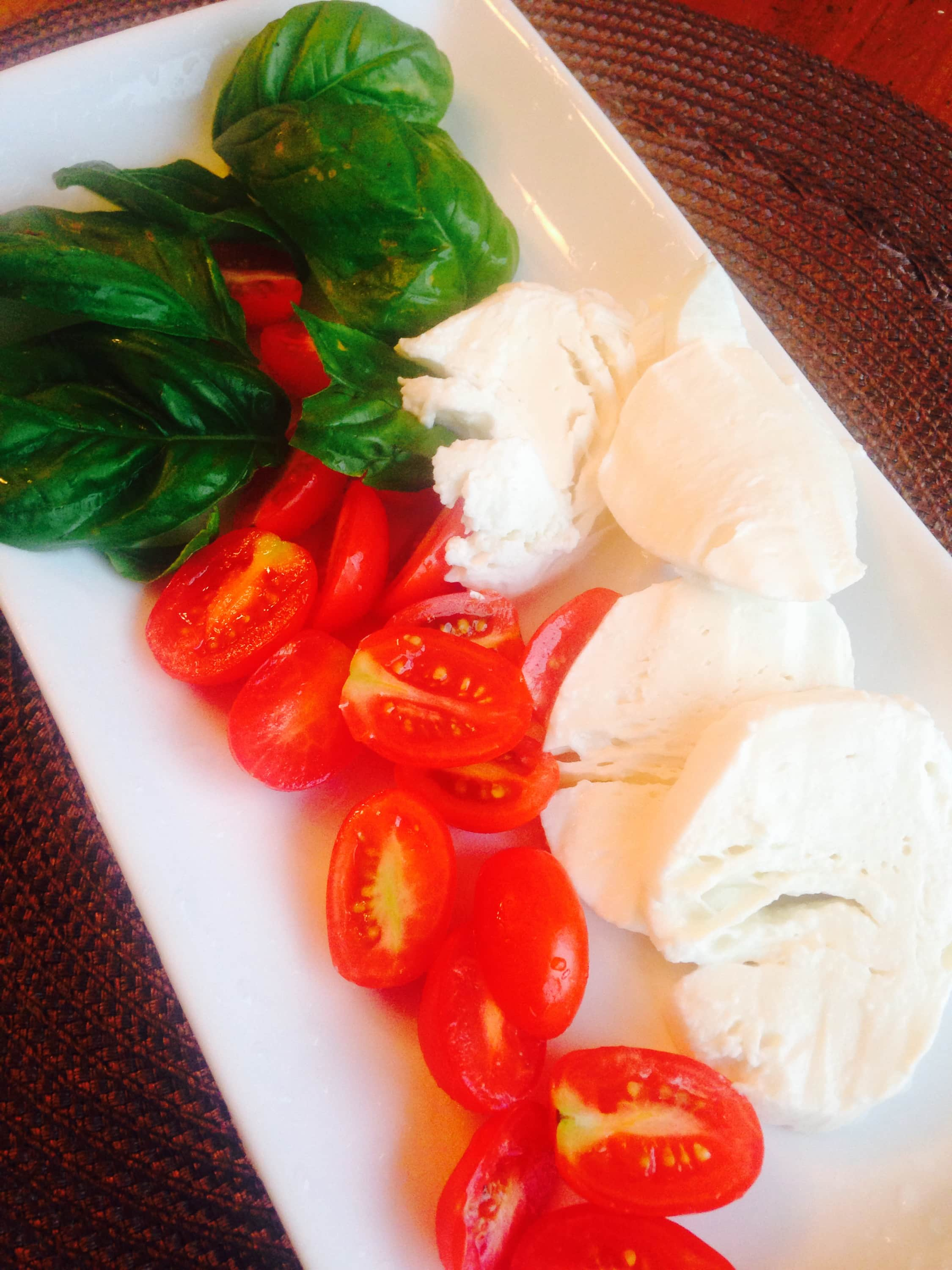 Fresh tomatoes, basil, and mozzarella cheese, used to make easy caprese chicken - a 21 Day Fix recipe.