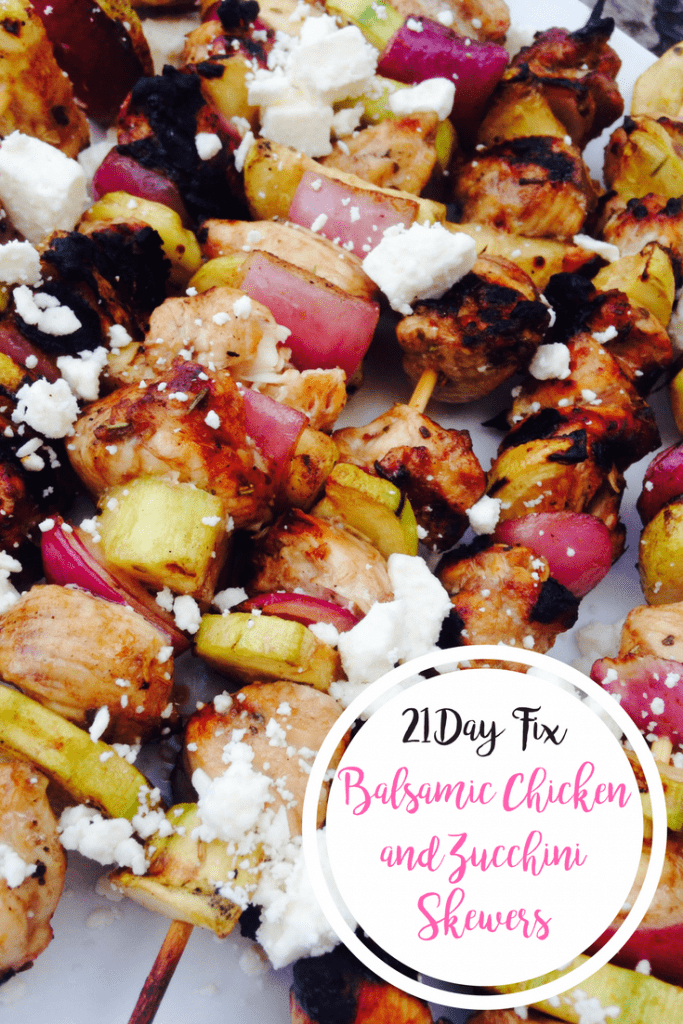 Balsamic marinated chicken, zucchini, and red onion are alternated on skewers and grilled, then topped with feta- with the text overlay 21 Day Fix Balsamic Chicken and Zucchini Skewers