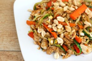 Plate of Zucchini Noodles with chicken, peanuts, carrots and pad Thai sauce