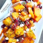 Warm Honey Roasted Butternut Squash Salad, with fresh cranberries and goat cheese. Recipe from Confessions of a Fit Foodie