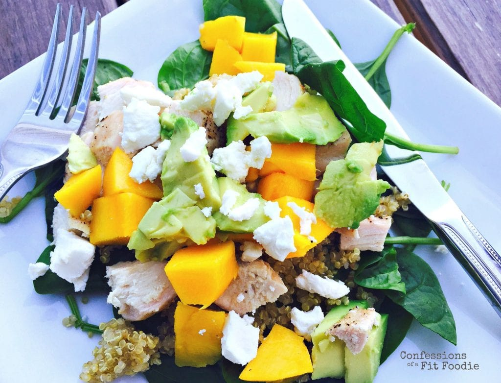 Featured salad photo of avocado mango and quinoa salad from Ultimate Healthy Chicken Recipe Roundup from the blog, Confessions of a Fit Foodie