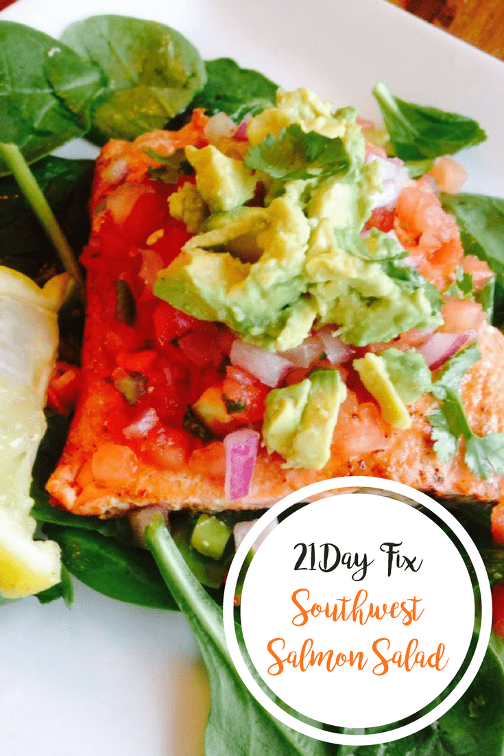 Southwest Salmon over spinach topped with diced ed onion, fresh salsa, cilantro, and avocado with a lemon wedge on the side