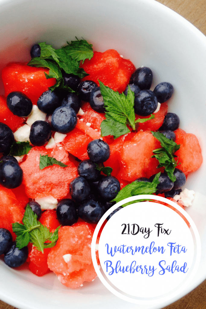 Watermelon, blueberries, feta, and mint mixed up in a white bowl with the text overlay- 21 Day Fix Watermelon Feta Blueberry Salad