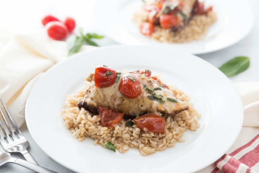 Caprese Chicken on a Plate over Brown Rice