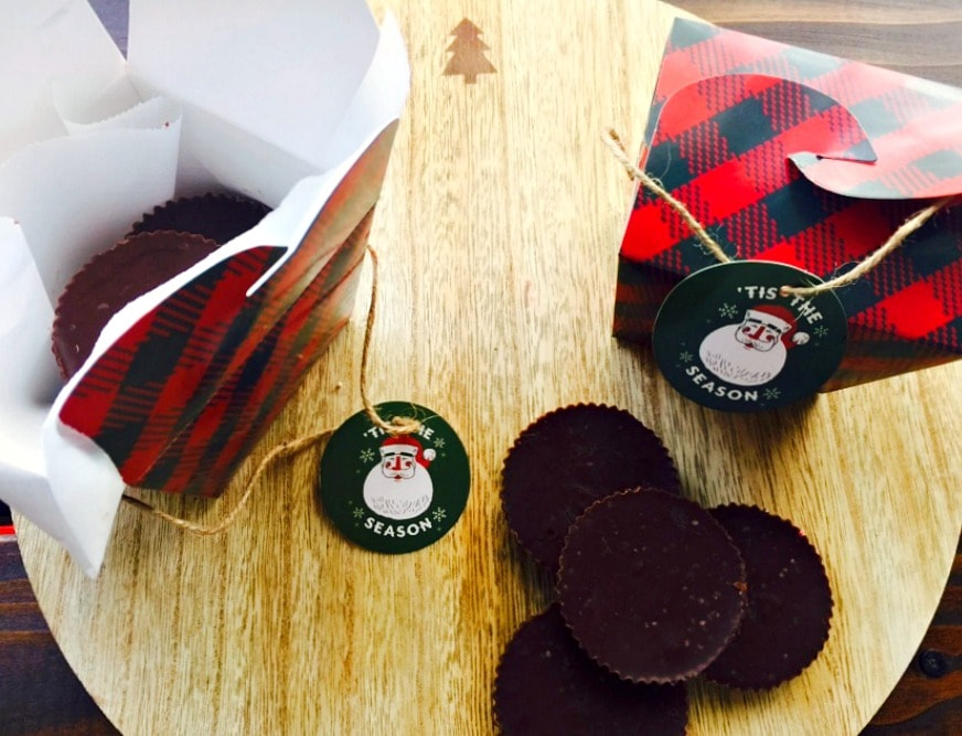 Peanut butter chocolate fudge next to green and red plaid treat boxes