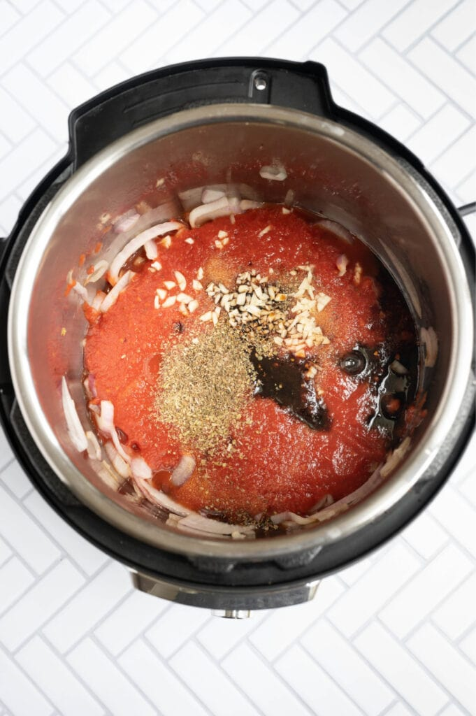Overhead photo of an Instant Pot full of ingredients ready for balsamic chicken