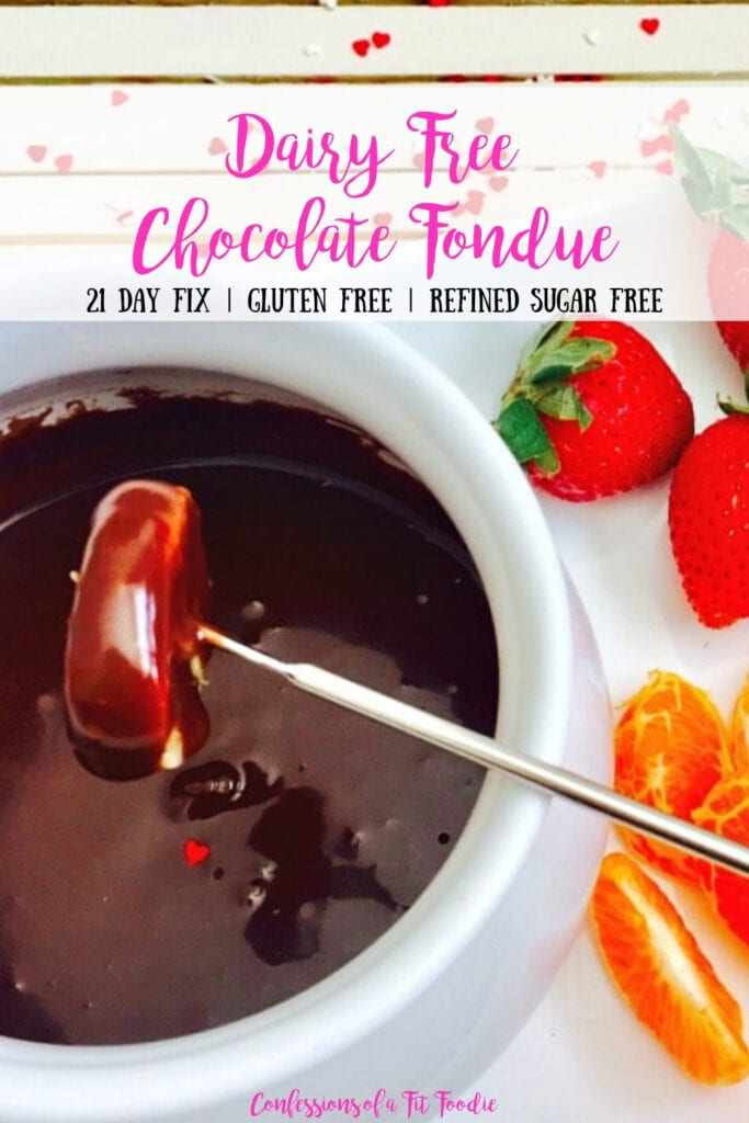 Close up photo of chocolate fondue recipe with a mandarin orange dipped into the white bowl. Extra fruit is off to the side. There is a text overlay- Dairy Free Chocolate Fondue | 21 Day Fix | Gluten Free | Refined Sugar Free | Confessions of a Fit Foodie