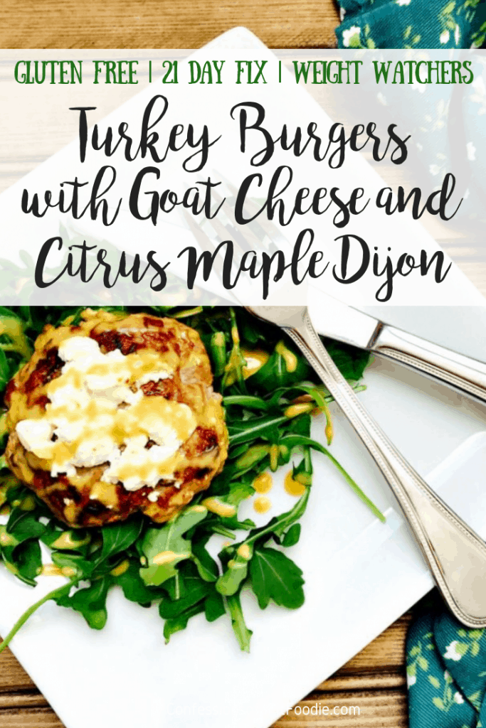Overhead photo of an easy turkey burger on a bed of arugula, with a green and black text overlay - Gluten Free | 21 Day Fix | Weight Watchers | Turkey Burgers with Goat Cheese and Citrus Maple Dijon