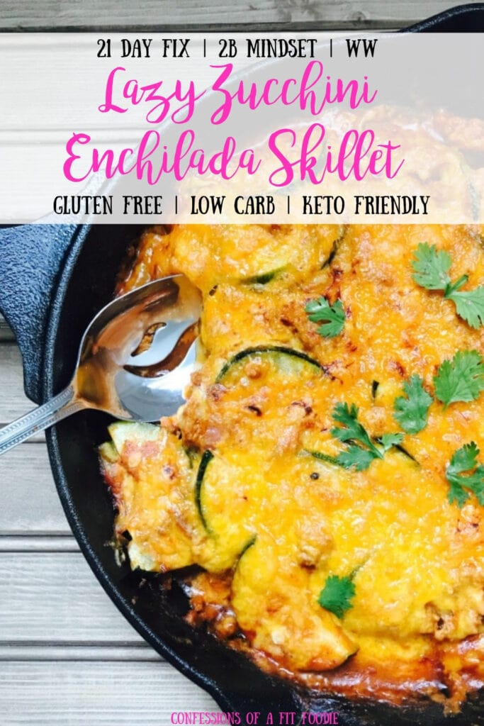 A cast iron skillet full of meat, zucchini, and enchilada sauce topped with melted cheddar cheese and cilantro. With the text overlay- 21 Day Fix | 2B Mindset | WW | Lazy Zucchini Enchilada Skillet | Gluten Free | Low Carb | Keto Friendly| Confessions of a Fit Foodie