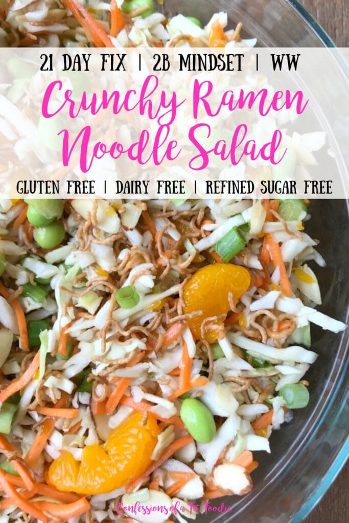 Close up of Ramen Noodle Salad Tossed Together in a glass bowl on a wooden surface. With the text overlay- 21 Day Fix | 2B Mindset | WW | Crunchy Ramen Noodle Salad | Gluten Free | Dairy Free | Refined Sugar Free | Confessions of a Fit Foodie