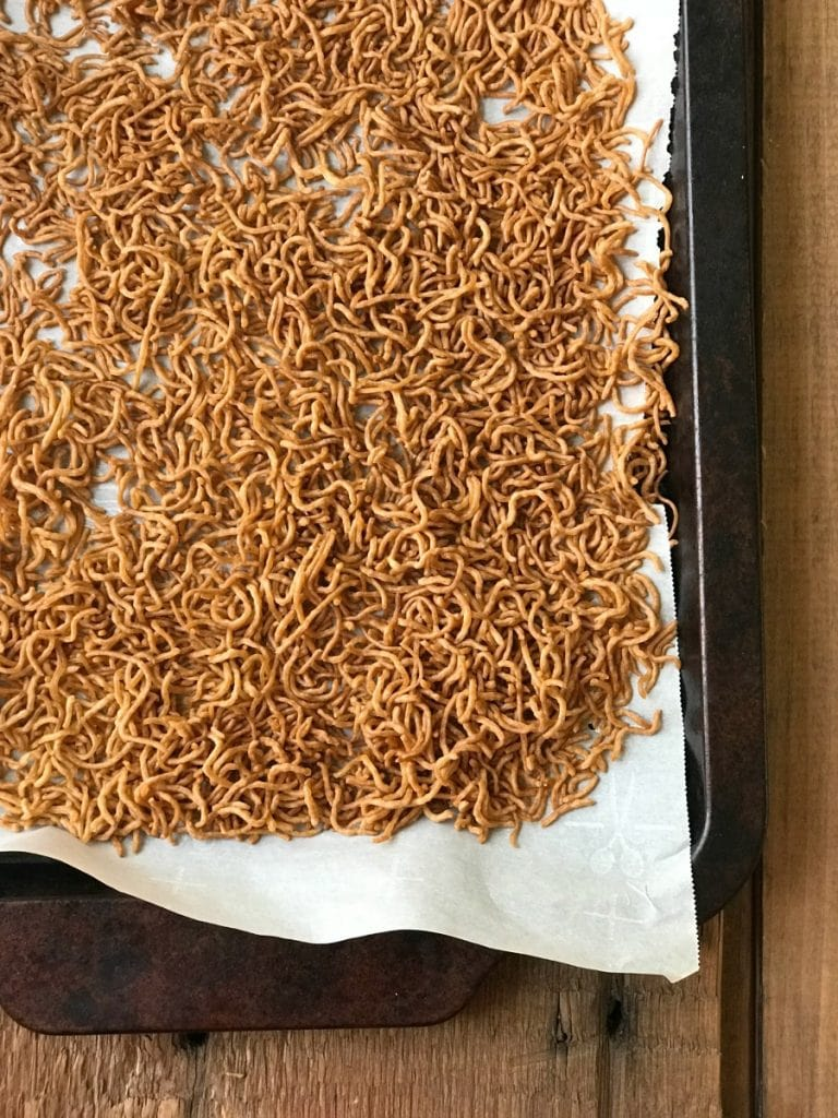 Toasted Ramen Noodles on a parchment paper lined Sheet Pan