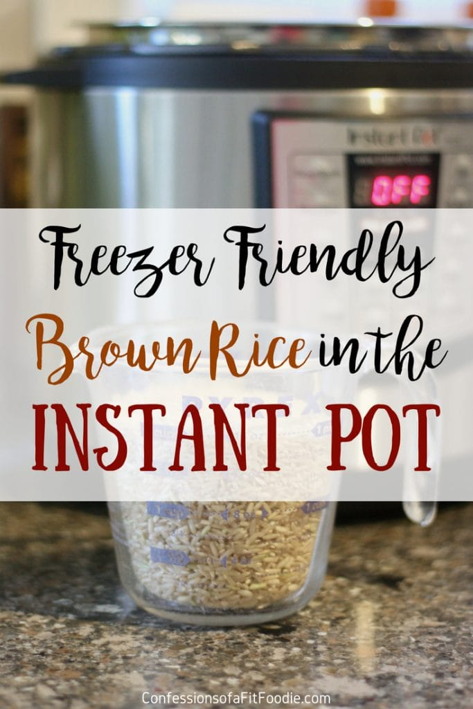 Glass measuring cup filled with brown rice with an Instant Pot in the background, with the text overlay- Freezer Friendly Brown Rice in the Instant Pot | Confessions of a Fit Foodie
