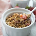 Ramekin with a Spoon full of Healthy Strawberry Rhubarb Crisp