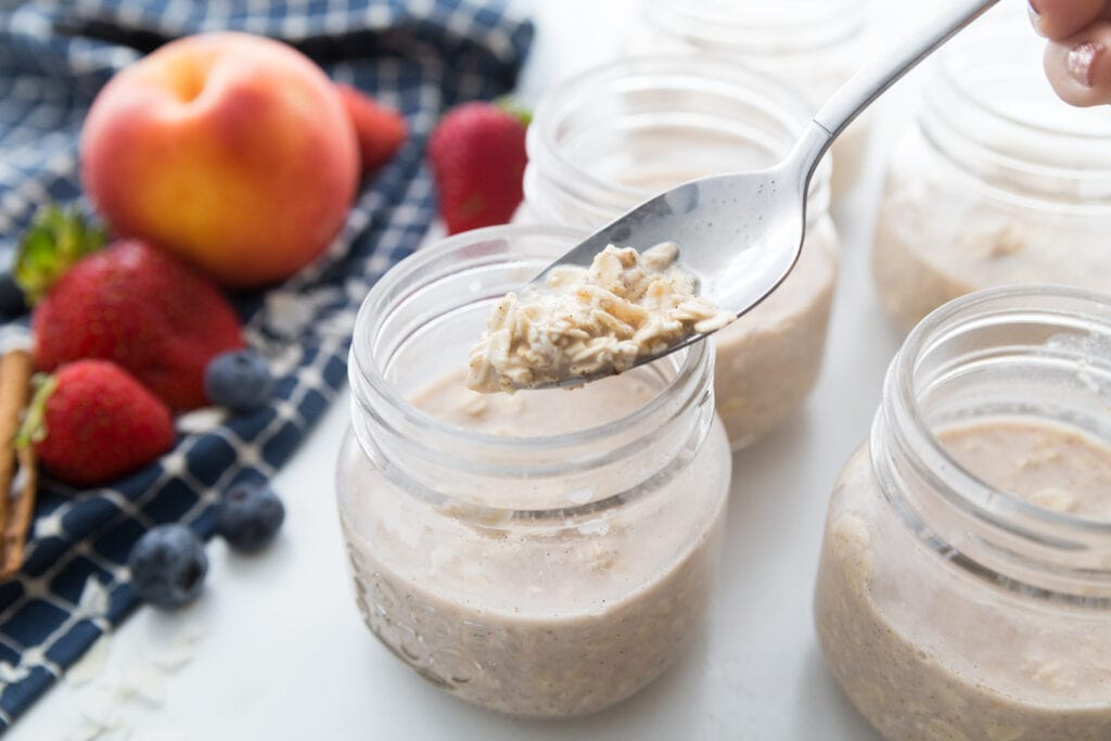Overnight Oats being divided into mason jars
