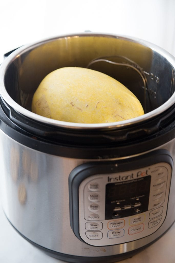 Photo of a whole spaghetti squash in an Instant Pot