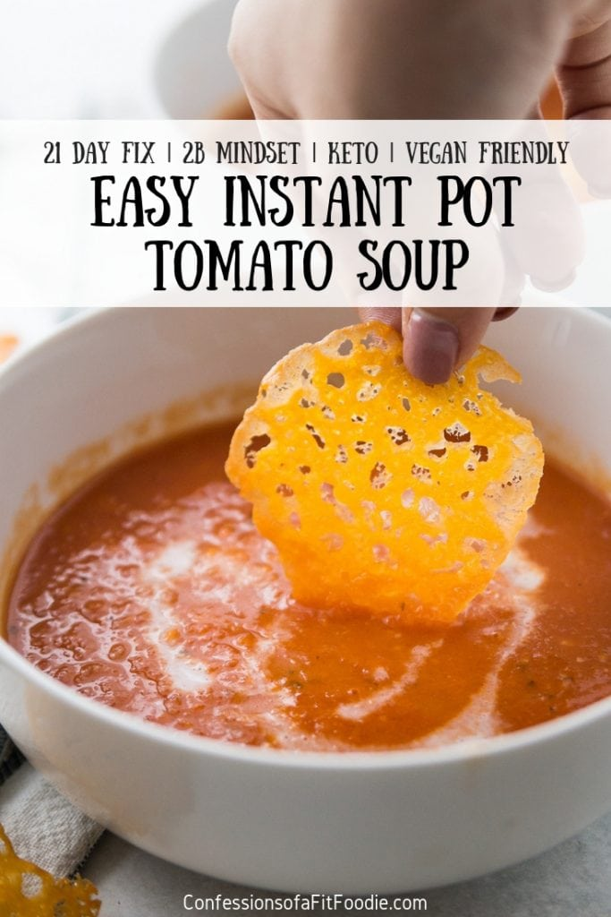 This creamy, delicious, and easy Instant Pot Tomato Soup is made with tomatoes, fresh basil, some veggies, a dollop of coconut cream.  Oh - and don't forget the crispy cheese chips for the perfect, low carb topping! This healthy comfort food soup is great for anyone following the 21 Day Fix, 2B Mindset, Liift 4, Keto, Weight Watchers, or any other nutrition plan. 21 Day Fix Instant Pot | Instant Pot Tomato Soup | Easy Tomato Soup | Healthy Tomato Soup | Keto Tomato Soup #21dayfix #healthyinstantpot #21dayfixtomatosoup #instantpottomatosoup #healthyinstantpot #confessionsofafitfoodie
