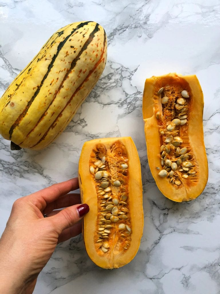 Delicata squash halves on a marble table