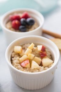 A small ramekin of Instant Pot Steel Cut Oats topped with banana and walnuts.