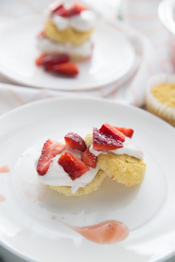 Individual strawberry shortcakes on a white plate