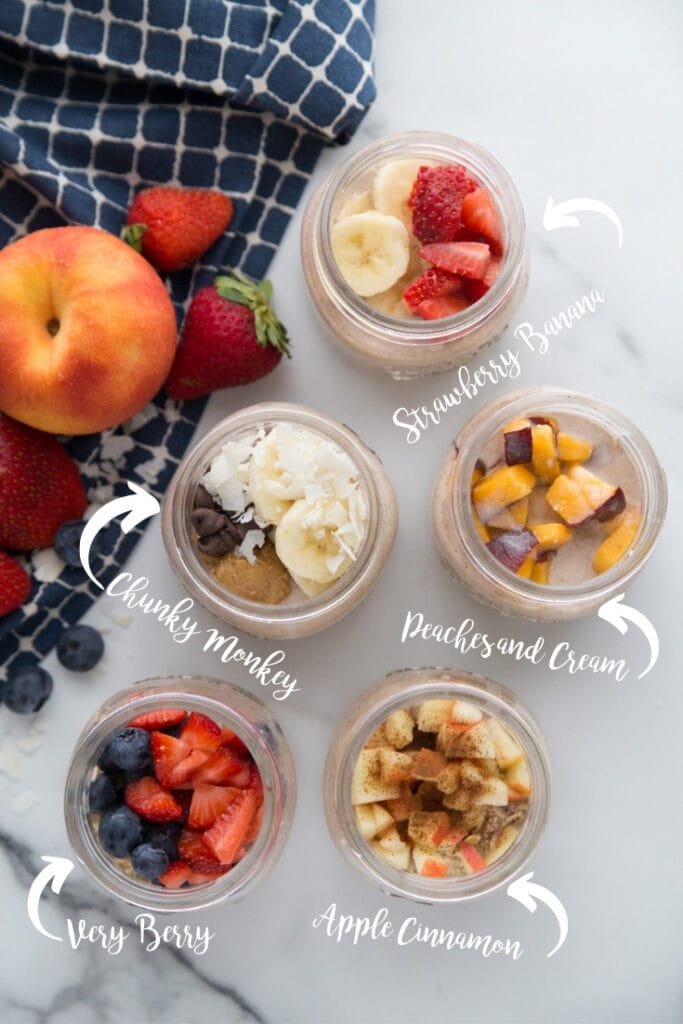 Overnight oats labeled with different flavors- chunky monkey, strawberry banana, peaches and cream, apple cinnamon, and very berry