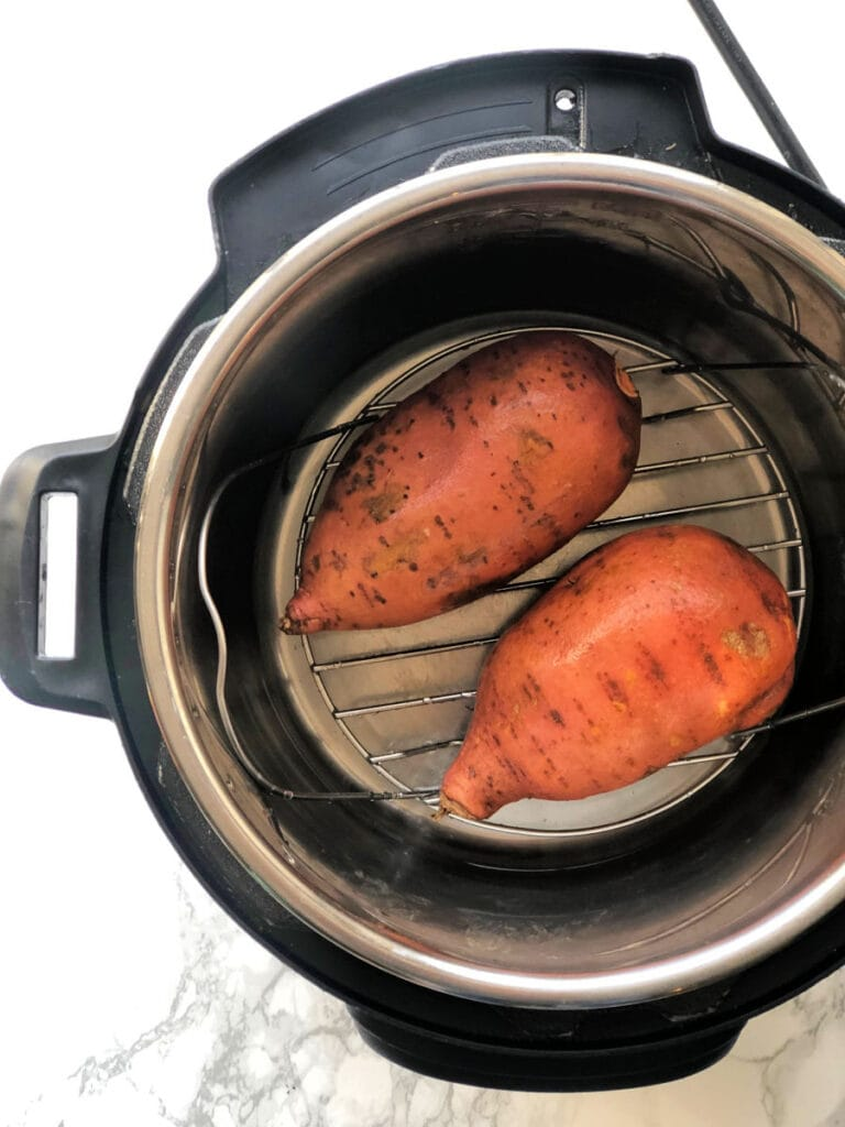 A photo of two sweet potatoes in the Instant Pot