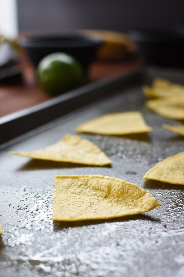 Homemade corn tortilla chips on a sheet pan