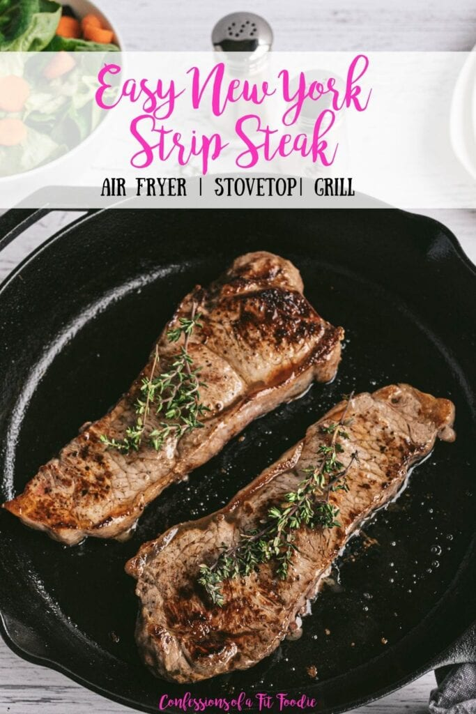 Overhead photo of Two New York Strip Steaks grilled in a Cast Iron Skillet with salt and pepper shakers and a salad in the background. With the text overlay- Easy New York Strip Steak | Air Fryer | Stovetop | Grill | Confessions of a Fit Foodie
