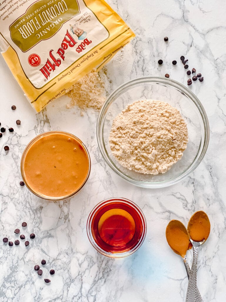 Ingredients to make No Bake Peanut Butter Cookies: Bob's Red Mill Coconut Flour, Peanut Butter, Maple Syrup.