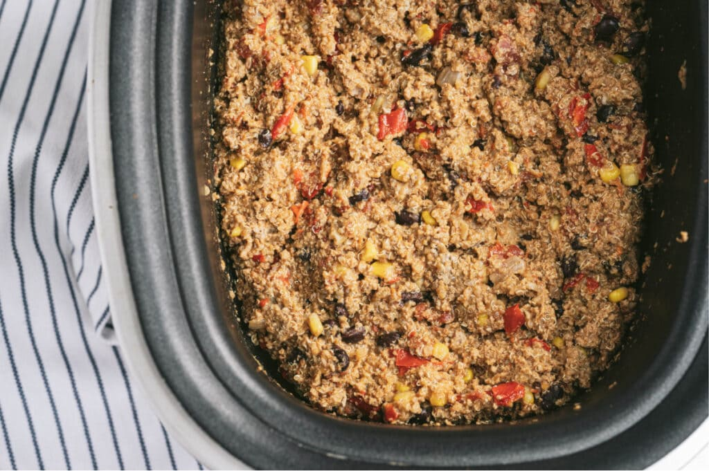 Overhead photo of crock pot taco casserole made with ground turkey, quinoa, diced tomatoes, corn, and black beans.