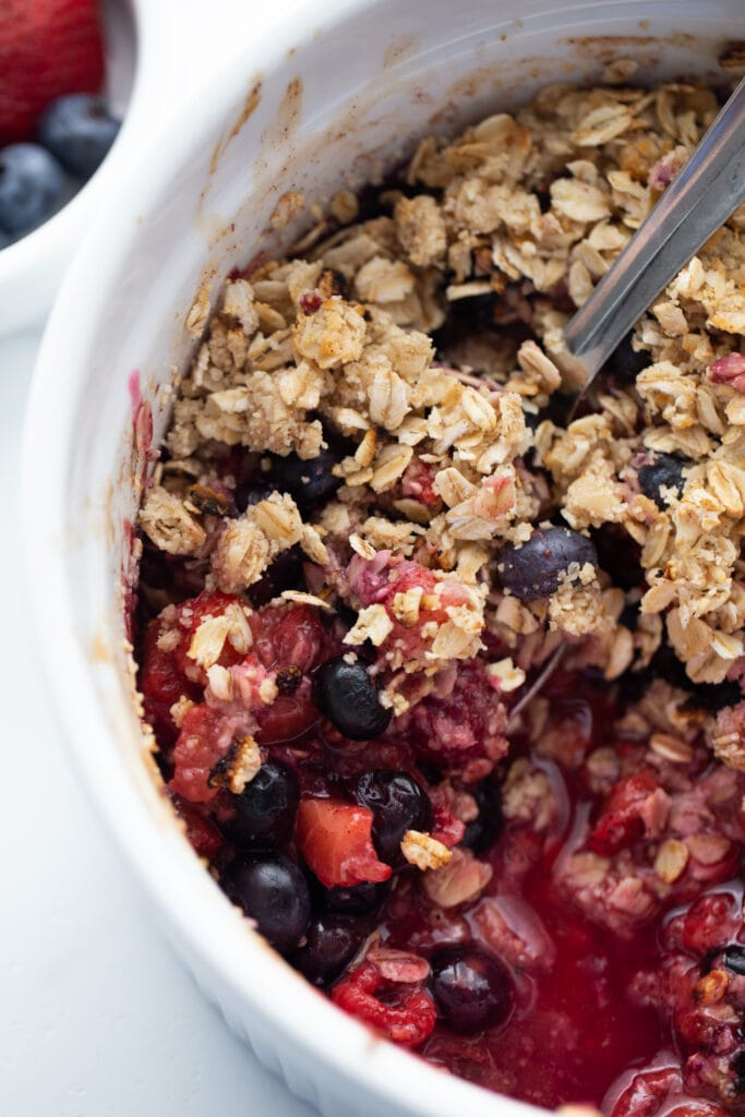 Large casserole dish of mixed berry crisp topped with gluten free oats, made in the Instant Pot.