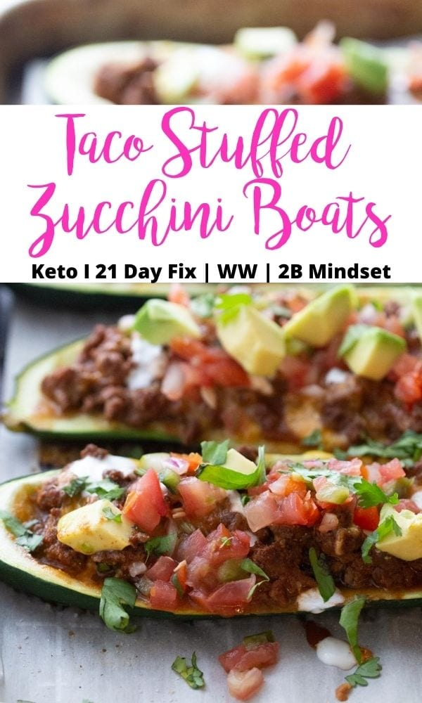 Close up photo of zucchini boats with a black and pink text overlay- Taco Stuffed Zucchini Boats | Keto | 21 Day Fix | WW | 2B Mindset