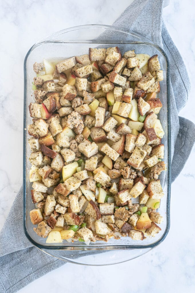 Overhead photo of gluten free stuffing in a glass baking dish, ready for the oven.
