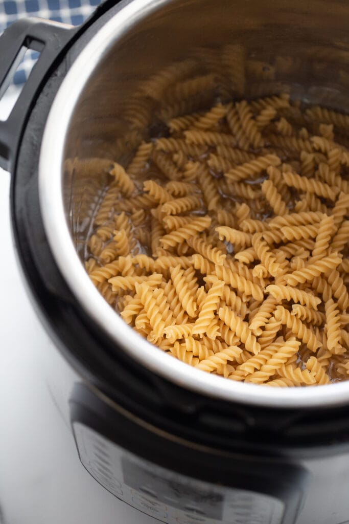 Overhead photo of raw rotini pasta in the instant pot