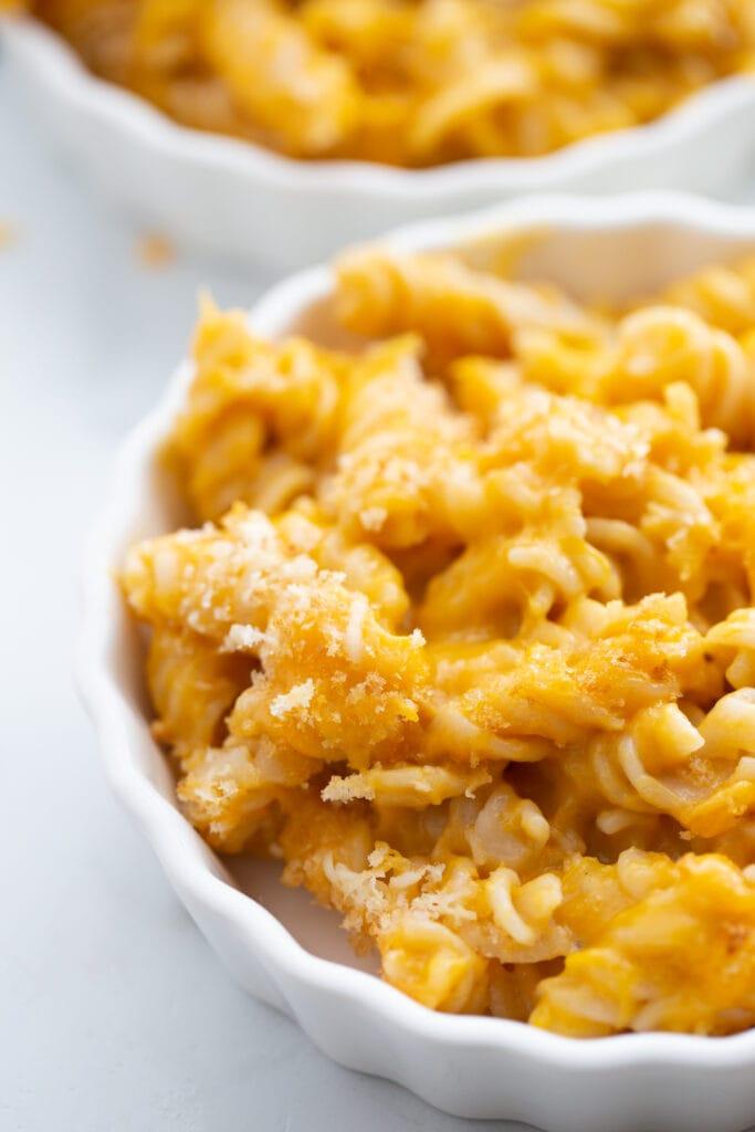 close up photo of mac and cheese in a white ramekin
