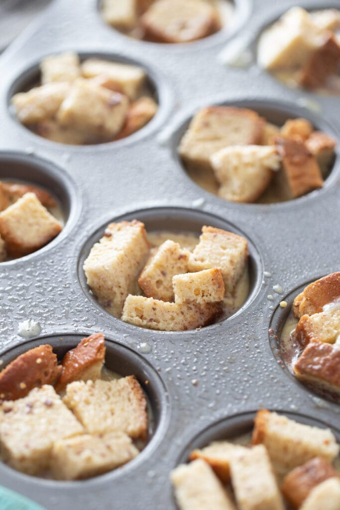 Bread cubes are in cupcake tins.