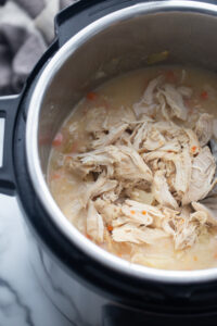 Shredded chicken is in the Instant Pot.