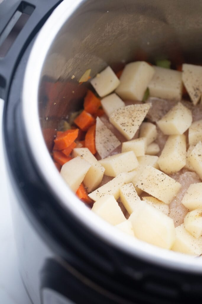 Potatoes and carrots are set in the Instant Pot.