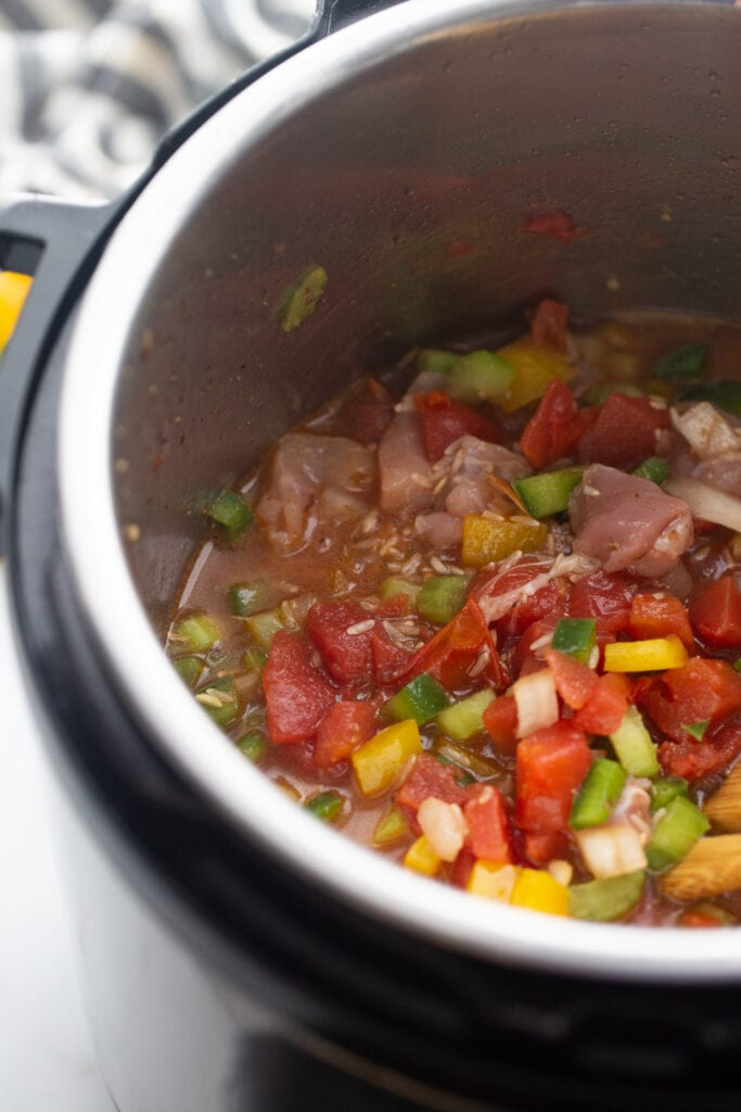 Red peppers are mixed with other veggies in the Instant Pot.