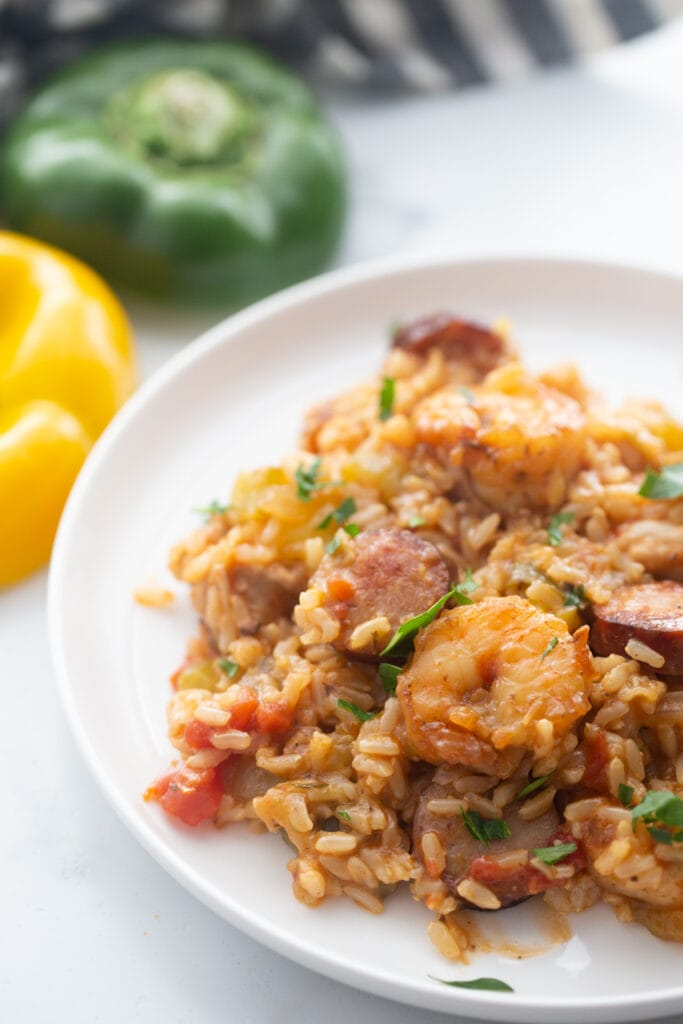 A serving of jambalaya is presented on a white plate.