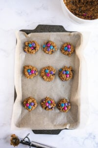 Nine cookies are on a prepared baking sheet.