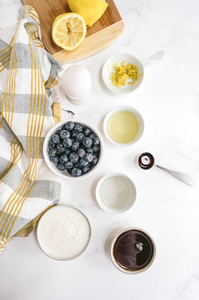 Ingredients for Lemon Blueberry Bread on a white marble table