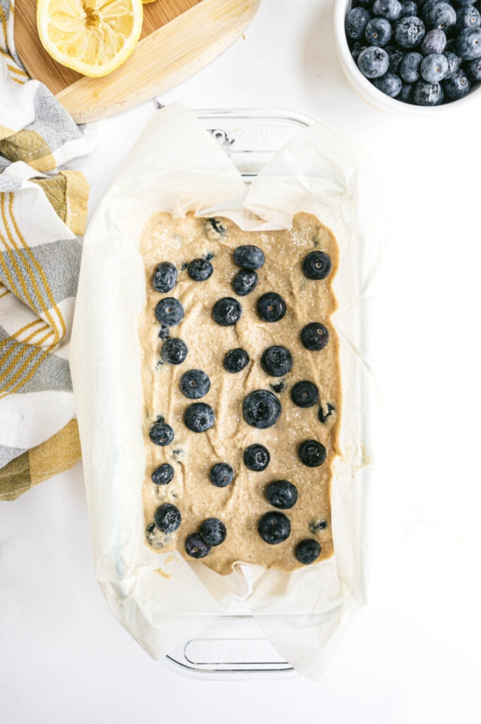 Overhead photo of lemon blueberry batter in a loaf pan