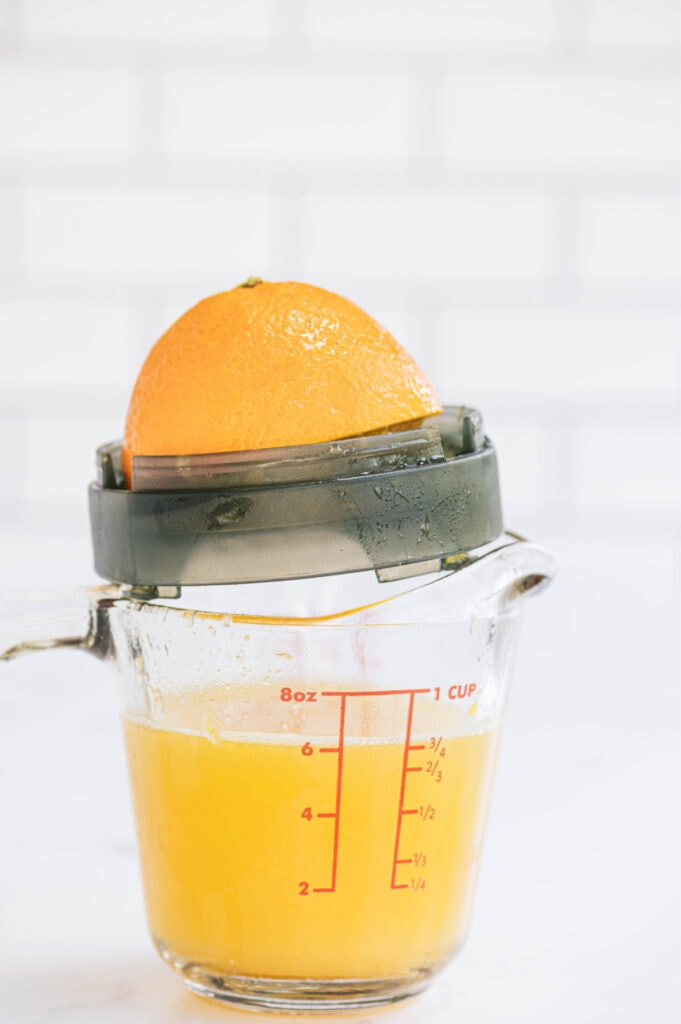 Freshly squeezed orange juice in a measuring cup
