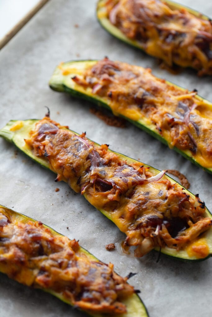 BBQ chicken stuffed zucchini boats straight from the oven, ready for garnish
